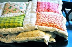 cheater quilt.....sew squares on a down comforter