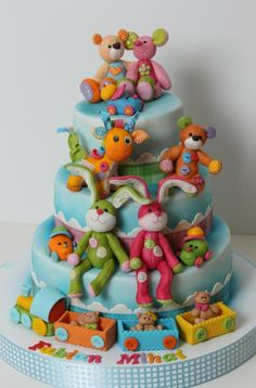 Fabian's favorite toys were made of fondant by me. https://www.facebook.com/Vioricascakes http://www.viorica-torturi.ro/