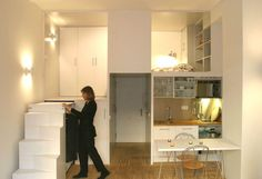 A multi-functional small space done in all white. White stairs, white cabinets…
