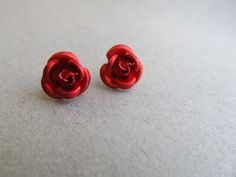 Red Rose Stud Earrings Red Queen    I bet the YCLs would love these. I know someone who could get us the supplies. Maybe they could make them at one of our meetings.
