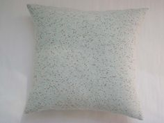 Merino lambswool is lightly felted and speckled with a copper lurex slub, to make these luxuriously soft cushions.
