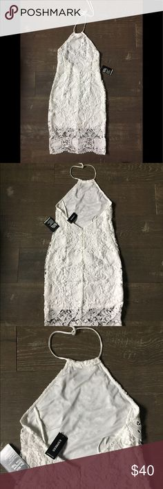 NEW White lace halter dress new with tags Express NWT Express white dress never worn. Tags attached. Great for beach wedding, bridal shower, summer party. You will love this!   Size 2 gorgeous and fits great! Excellent price for such a cute good quality dress.   Thank you for looking and please check out my closet!   Bundle for further savings! Express Dresses