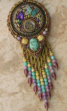 This wonderful necklace has a mosaic center piece made from crystal clay with butterfly. Bead embroidery finishes the piece with some amazing Seed Bead Jewelry, Jewelry Art, Beaded Jewelry, Beaded Necklace, Jewellery, Bead Embroidery Jewelry, Beaded Embroidery, Beaded Brooch, Beads And Wire