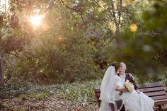 Rancho Santa Ana Botanic Garden Wedding Pictures- Beautiful sun-flare romantic shot.