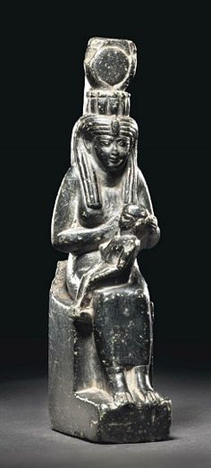 A carved limestone ancient egyptian stele depicting queen