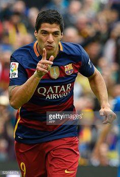 Barcelona's Uruguayan forward Luis Suarez celebrates after scoring a goal during the Spanish league football match FC Barcelona vs RCD Espanyol at...