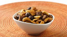 Two kinds of chili powder perk up this decadent dark chocolate Chex mix. Bet you can't just have one handful!