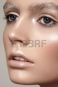 Amazing fashion winter make-up with bright shiny skin, pale lips, sparkles eyebrows Beautiful christmas celebratory woman look Stock Photo - 19509062