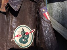 """Close-up of Fighter Squadron insignia, the """"Twin Dragons"""" emblem on an flight jacket Patch on the shoulder is the C. Leather Flight Jacket, Nose Art, Wwii, Dragons, Theater, India, China, Shoulder, Jackets"""