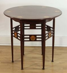 An Arts and Crafts period mahogany and inlaid occasional table in the Voysey style, circa 1900