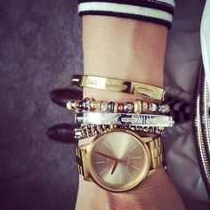 25 reasons you can (and should) mix gold and silver accessories // Arm party with gold watch + silver and gold bangles.