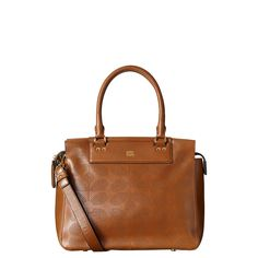 Orla Kiely: Soft leather bag with punched Sixties Stem detail on front and back. Zip to close. Gold colored hardware. Adjustable, detachable long leather strap so that the bag can be worn across the body (max 47.2in).  Gold colored coating on inside of bag.