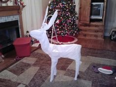 Tired of my lights burning out on my reindeer so i took them off and wrapped it in white trash bags. Now they are in the yard with a spot light. No more fixing lights!