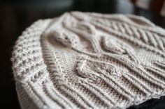 The Renae Hat $4 | The Renae Hat alternates leafy vines and a climbing trellis insert for a lush and feminine hat with a bold twist. deeprootsknits.etsy.com  #knithat #knittingpattern #hatpattern