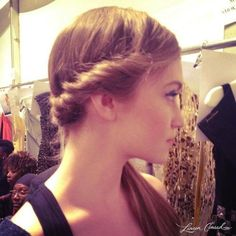 Surprisingly normal-looking runway hair from fashion week: Side roll to low ponytail.  I might actually wear that!