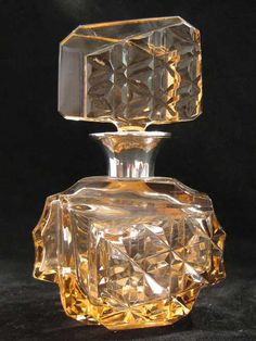 A rare 1950s Cubist design, French perfume bottle with a silver collar.