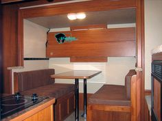 Ssssweeeet!!!  This is Fold-down Bunk Bed for over a Dinette or Sofa in a Living Quarters Horse or Toy Hauler Trailer.