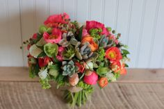 Late May bridal bouquet with peonies, poppies, hellebores, nigella, succulents and more.  Designed by Love 'n Fresh Flowers.