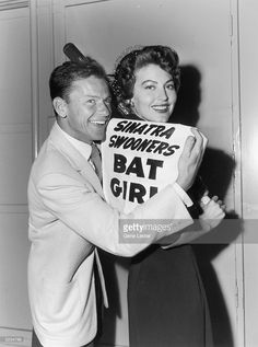 American actors Frank Sinatra (1915 - 1998) and Ava Gardner (1922 - 1990) pose with a sign that reads, 'Sinatra Swooners Bat Girl,' July 12, 1949. Gardner holds a baseball bat over her shoulder while Sinatra holds the sign up to her back. The Swooners were Sinatra's charity baseball team, which was made up of MGM contract players.