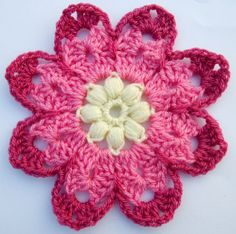 Free written crochet pattern for an octagon flower motif. Motifs can be joined together to form a scarf or blanket, etc.