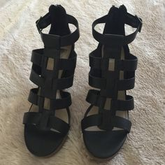 """Dolce Vita black gladiator wedges Features gladiator silhouette, adjustable ankle strap with buckle enclosure, open toe, and stacked wedge heel at 4.25"""" (stacked platform at 1 and heels at 3.25""""). New in box. Dolce Vita Shoes Sandals"""
