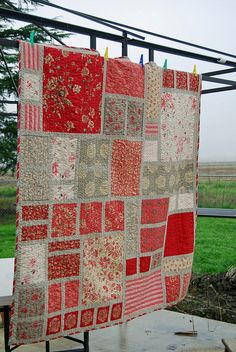 Love the odd pattern of this quilt - can't mess up! Cut pieces from old clothing to make a memory quilt!
