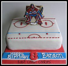 Goalie (Hockey) Cake with decorated cookies..  Learn Amazing #Cakes #Design on Cake Decorating Courses http://CakeDecoratingCoursesOnline.com