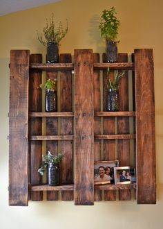 Pallet as wall display shelves. Pull out selected slats, stain and hang. Good for a rustic cabin interior or wabi sabi exterior patio. I could see this on my fence filled with small flower pots or succulents.