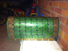 Recycled snuff lids glued onto a mailbox