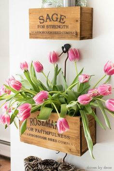 Wall-mounted farmhouse nesting herb crates filled with tulips