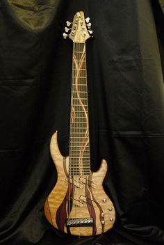 Combat Guitars AYA 7-string bass... like the pickup setup
