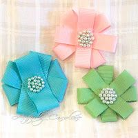 hair bows with little beads sewn into the center
