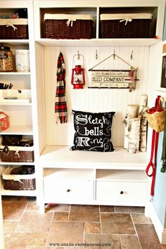 DIY chalk writing pillow in Christmas mudroom with red lantern and sled  www.goldenboysandme.com