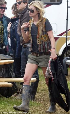 Kate Moss shows wellies are a essential item to survive Glastonbury!