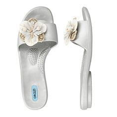 Jen, with its intricate flower detail, available in Pearl and Salt makes this slide easy to pair with your resortwear.