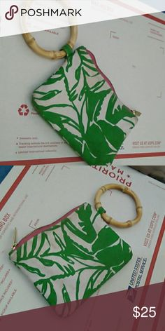 Lilly Pulizer wristlet purse Fun print and bamboo bangle strap keeps it secure. Slightly used but great condition. Gold and pink zipper. Lilly Pulitzer for Target Bags Clutches & Wristlets