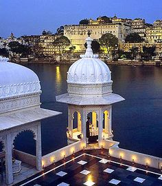 "Taj Lake Palace, Udaipur, India. Lake Palace, the 250-year-old former summer palace of the Maharaja of Udaipur, is one of the world's most breathtaking heritage hotels, and to spend a night here is truly a fairytale experience that begins the moment you first see it. Floating in tranquil Lake Pichola with the Aravelli Hills as its backdrop, this palace hotel has been called ""a dream of white marble.""  #RePin by AT Social Media Marketing - Pinterest Marketing Specialists ATSocialMedia.co.uk"