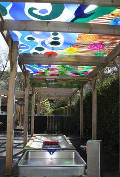 Water play under a beautiful pergola.- Oh, for an outdoor classroom! Outdoor Learning Spaces, Outdoor Play Areas, Outdoor Fun, Kids Outdoor Spaces, Preschool Playground, Sensory Garden, Backyard Play, Backyard Games, Outdoor Playground