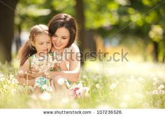 Mother and daughter in the park by suravid, via ShutterStock