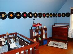 I like the records along the walls for a music themed room.