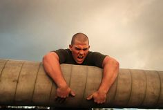 A Marine recruit muscles his way through an obstacle course during boot camp (U.S. Marine Corps photo by Cpl. Caitlin Brink/Released)