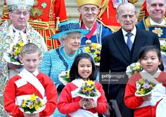 Queen Elizabeth II and Prince Philip, Duke Of Edinburgh attend the traditional Royal Maundy Service at Windsor Castle on March 24, 2016 in Windsor, England.  (Photo by Anthony Harvey/Getty Images)