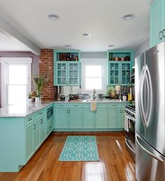 The brick and the Colored Cabinets!
