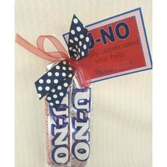 """The tag reads """"U-NO I really appreciated your help. Thank You!"""" It's wrapped up with two U-NO candy bars."""