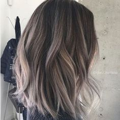 Take your two tone hair color idea to a more subtle level by leaving the bulk of your mane a delightful dark brown tint while adding some simple grey and blonde highlights throughout. They instantly perk up your style and add some brightness to your complexion.
