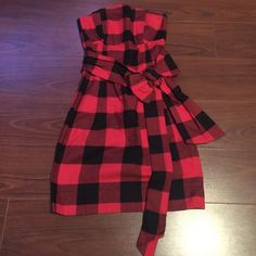 H&M Red & Black Lumberjack Checkered Dress Brand New, Tags Attached! H&M Black and Red Lumber Jack Checkered Plaid, Strapless Dress. With a big adjustable accent bow on the front. Size 2 H&M Dresses Strapless