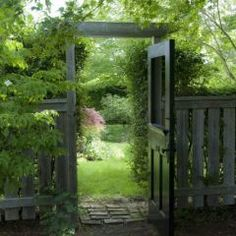 Such a great idea to use an old entry door but cut-out the top panel. Love that it's black too and non-obtrusive.