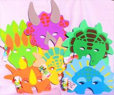 Set of 6 colorful foam dinosaur masks. Fun for kids to play their favorite pre-historic beast. Each mask is different colors and shapes. - Birthday party of 6. - Dinosaur unit for pre-school class. -