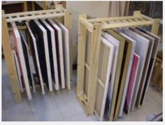 "Could be used for screens too. ""The folks on The Wet Canvas forum have shared several ideas for modifying a store bought shelving unit to create an upright storage rack for drying or storing paintings."""