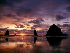 Cannon Beach Sunset  Just about 80 miles west of Portland sit Cannon Beach and its famous Haystack Rock, a 235-foot sea stack. #Oregon #iGottaTravel